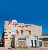 Pintura, cowgirl en la pared, Las Vegas New México Imágenes de archivo libres de regalías