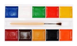 Pintura da aquarela com a escova isolada no fundo branco imagem de stock
