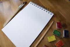 Pintura da aquarela no caderno imagem de stock