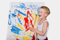 Pintura da criança com imagem do pincel na armação Educação creatividade imagens de stock
