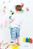 Pintura da criança na parede Imagem de Stock Royalty Free