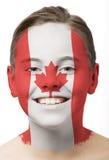 Pintura da face - bandeira de Canadá Foto de Stock Royalty Free