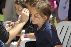 Pintura da face das crianças Foto de Stock
