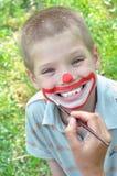 Pintura da máscara protectora do miúdo Imagens de Stock