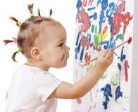 Pintura da menina em uma placa Foto de Stock Royalty Free