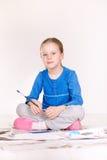 Pintura da menina no assoalho Fotos de Stock Royalty Free