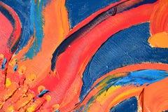 Pintura de óleo vermelha abstrata no fundo azul Fotos de Stock