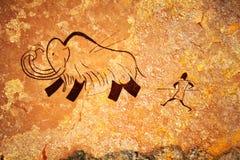 Pintura de cuevas de la caza primitiva Imagen de archivo
