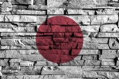 Pintura de la bandera de Japón sobre el alto detalle de la pared de ladrillo vieja libre illustration