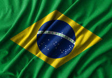 Pintura de la bandera del Brasil sobre el alto detalle de las telas de algodón de la onda foto de archivo libre de regalías