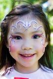 Pintura de la cara del niño Imágenes de archivo libres de regalías