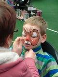 Pintura de la cara del niño Fotografía de archivo