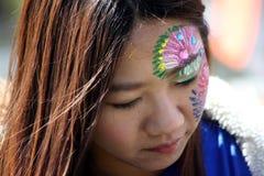 Pintura de la cara en el festival cultural Fotos de archivo libres de regalías