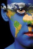 Pintura de la cara - mundo imagen de archivo
