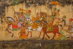 Pintura de pared india del montante antiguo tradicional en la pared enyesada vieja en Udaipur, la India Fotografía de archivo