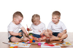 Pintura de tres muchachos Fotografía de archivo