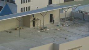 Pintura de un edificio nuevamente construido, Moresby almacen de metraje de vídeo