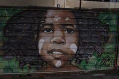Pintura de un muchacho en la pared fotografía de archivo libre de regalías
