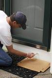 Pintura debajo de la puerta principal Imágenes de archivo libres de regalías