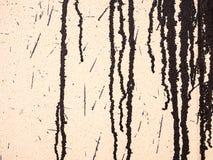 Pintura del goteo en una pared Imagenes de archivo
