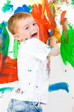 Pintura del niño y diversión el tener Foto de archivo libre de regalías