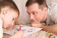 Pintura del padre y del hijo Fotos de archivo
