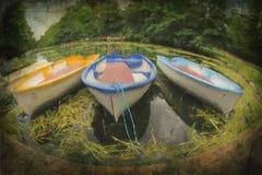 Pintura del tres barcos amarrados Imagenes de archivo