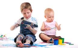 Pintura do menino e da menina imagem de stock royalty free