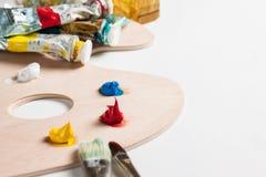 Pintura e escovas de pintura Imagens de Stock