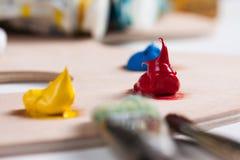 Pintura e escovas de pintura Foto de Stock