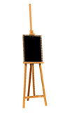 Pintura en blanco y caballete de madera Imagen de archivo libre de regalías
