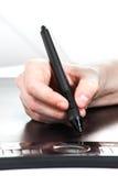 Pintura en la tableta de la pluma Fotos de archivo