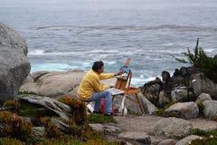 Pintura en rocas del caballete de la pintura de la lona del mar foto de archivo