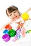 Pintura feliz da menina com pinturas do dedo fotografia de stock