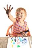 Pintura feliz joven de la muchacha en el papel. Imagen de archivo