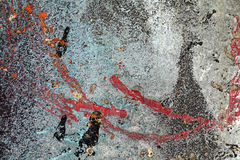 Pintura gris roja pelada agrietada de la turquesa en la pared dañada vieja Foto de archivo