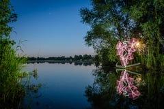 Pintura ligera al lado de un lago Imágenes de archivo libres de regalías