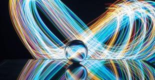 Pintura ligera con la bola de cristal imagen de archivo