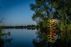 Pintura ligera en el lago Fotografía de archivo
