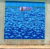 Pintura mural de uma casa no meio do mar em uma passagem subterrânea da ponte em James Road em Memphis, Tennessee Foto de Stock