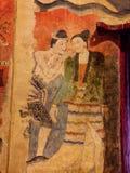Pintura mural de un hombre que susurra al oído del a mujeres en el wat Phumin, NaN, Tailandia Fotografía de archivo libre de regalías