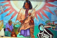A pintura mural diz a história de povos dos americanos dos mexicanos foto de stock royalty free