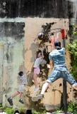 Pintura mural famosa da arte da rua em George Town fotografia de stock