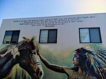 Pintura mural na loja imagens de stock