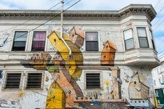 Pintura mural na vizinhança do distrito da missão em San Francisco foto de stock royalty free