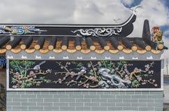 Pintura oriental do relevo no templo chinês Fotos de Stock Royalty Free