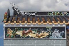 Pintura oriental do relevo no templo chinês Foto de Stock