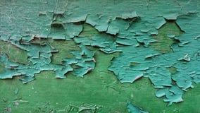 Pintura seca verde que lasca-se fora da madeira fotos de stock royalty free