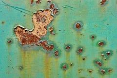 Pintura velha da casca no fundo oxidado de Grunge do metal foto de stock