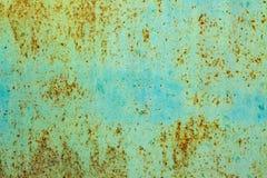 pintura verde de la textura del fondo en el hierro con moho fotos de archivo libres de regalías